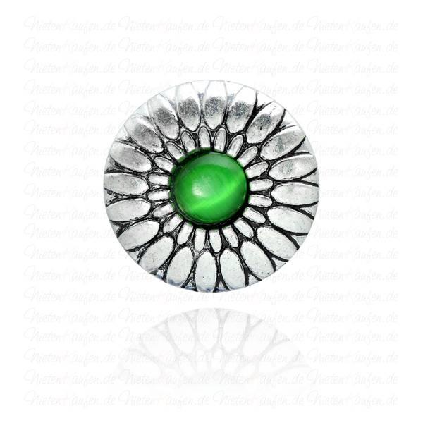 Chunk Button aus Metall mit grünen CatEye